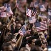 Supporters wave flags during President Barack Obama\'s election night party Tuesday, Nov. 6, 2012, in Chicago. President Obama defeated Republican challenger former Massachusetts Gov. Mitt Romney. (AP Photo/M. Spencer Green)