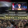 Photo -   Egyptian President Mohammed Morsi is seen on a large screen as he speaks to a packed stadium on the 6th of October national holiday marking the 1973 war with Israel, Cairo, Egypt, Saturday, Oct. 6, 2012.(AP Photo/Khalil Hamra)