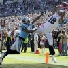 Photo - St. Louis Rams' Austin Pettis (18) catches a pass over Carolina Panthers' Josh Thomas (22) in the first half of an NFL football game in Charlotte, N.C., Sunday, Oct. 20, 2013. Pettis was ruled out of bounds on the play. (AP Photo/Mike McCarn)