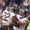 Chicago Bears running back Matt Forte (22) celebrates his touchdown with teammate Eric Weems (14) against the Arizona Cardinals during the first half of an NFL football game, Sunday, Dec. 23, 2012, in Glendale, Ariz. (AP Photo/Paul Connors)