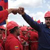 In this March 21, 2013 photo, released by Miraflores Presidential Press Office, Venezuela's acting President Nicolas Maduro fist bumps a worker of the state-run oil company PDVSA during a visit to the Orinoco oil belt in Venezuela. Maduro gathered hundreds of civil servants at the facility owned by PDVSA to ask support for his candidacy in the upcoming presidential elections to replace the late Hugo Chavez. The late leader transformed this country\'s enormous federal bureaucracy into nothing less than a political arm of the government, say former government workers and experts, with partisan loyalties trumping technical competence in hiring and ministries turning out thousands of civil servants for election year rallies. (AP Photo/Miraflores Presidential Office)