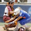 Kelsey Hoffman of Virginia Tech tags out Florida\'s Tiffany DeFelice in the ninth inning of the Women\'s College World Series between Florida and Virginia Tech at ASA Hall of Fame Stadium in Oklahoma City, Saturday, May 31, 2008. BY BRYAN TERRY, THE OKLAHOMAN