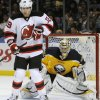 Photo - New Jersey Devils right winger Steve Bernier (18) reacts to an incoming shot as Buffalo Sabres goaltender Ryan Miller (30) looks on during the second period of an NHL hockey game in Buffalo, N.Y., Saturday, Jan. 4, 2014. (AP Photo/Gary Wiepert)