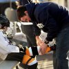 Scott Kilgore helps son Ty, 7, suit up at the Oklahoma City Youth Hockey Association\'s 8 and under league play at the Norman Outdoor Holiday Ice Rink on Saturday, Dec. 22, 2012 in Norman, Okla. Photo by Steve Sisney, The Oklahoman
