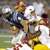 Edmond North\'s Luke Hoskins is brought down by Putnam City North\'s Ruben Hunter, top, Eric Sadler, and Wendell Mickel , bottom, during a high school football game at Wantland Stadium in Edmond, Okla., Friday, September 21, 2012. Photo by Bryan Terry, The Oklahoman