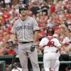 Photo - San Diego Padres' Jake Goebbert tosses his bat after being called out on strikes, as St. Louis Cardinals catcher Tony Cruz heads for the dugout in the second inning of a baseball game, Sunday, Aug. 17, 2014, in St. Louis. (AP Photo/Tom Gannam)