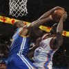 Oklahoma City \'s Serge Ibaka (9) goes against Golden State\'s Carl Landry (7) during an NBA basketball game between the Oklahoma City Thunder and the Golden State Warriors at Chesapeake Energy Arena in Oklahoma City, Sunday, Nov. 18, 2012. Photo by Garett Fisbeck, The Oklahoman