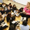 Teacher Kristin Whitmore works on a reading assignment with her third-graders from the book