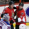 Photo - Ottawa Senators' Mika Zibanejad (93)celebrate his goal against the New York Rangers with teammate Clarke MacArthur (16) during first period NHL hockey action in Ottawa,  Ontario, Tuesday March 18, 2014.  (AP Photo/The Canadian Press, Fred Chartrand)