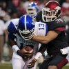 Photo -   Kentucky quarterback Jalen Whitlow (13) is sacked by Arkansas safety Ross Rasner (35) during the first quarter of an NCAA college football game in Fayetteville, Ark., Saturday, Oct. 13, 2012. (AP Photo/April L. Brown)