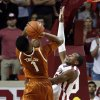 Oklahoma Sooner Buddy Hield (24) tries to block a shot by Texas Longhorn\'s Isaiah Taylor (1) in the second half as the University of Oklahoma Sooners (OU) men defeat the Texas Longhorns (TU) 77-65 in NCAA, college basketball at The Lloyd Noble Center on Saturday, March 1, 2014 in Norman, Okla. Photo by Steve Sisney, The Oklahoman
