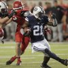 Photo -   BYU running back Jamaal Williams (21) cuts through the Utah defense during the second quarter of an NCAA college football game Saturday, Sept. 15, 2012, in Salt Lake City. (AP Photo/Rick Bowmer)