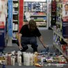 A man picks up fallen goods at a CVS store after an earthquake on Friday, March 28, 2014, in La Mirada, Calif. A magnitude-5.1 earthquake was widely felt in the Los Angeles area and surrounding counties Friday evening, but authorities said there were no immediate reports of significant damages or injuries. (AP Photo/Jae C. Hong)
