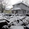 A pile of garbage in the street is covered with snow in the New Dorp section of Staten Island, N.Y., Thursday, Nov. 8, 2012. The New York-New Jersey region woke up to a layer of wet snow and more power outages after a new storm pushed back efforts to recover from Superstorm Sandy. (AP Photo/Seth Wenig)