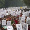 Indian women carry placards as they march to mourn the death of a gang rape victim in New Delhi, India, Wednesday, Jan. 2, 2013. India\'s top court says it will decide whether to suspend lawmakers facing sexual assault charges as thousands of women gathered at the memorial to independence leader Mohandas K. Gandhi to demand stronger protection for their safety. The banners read