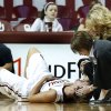 Whitney Hand is attended to by trainer Carolyn Loon and head coach Sherri Coale following an injury during the Sooners\' game vs. North Texas on Dec. 6, 2012. Hand tore her left ACL on the play, likely ending her collegiate career. PHOTO BY STEVE SISNEY, The Oklahoman
