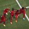 Photo - Ghana players dance after Asamoah Gyan, right, scored his side's second goal during the group G World Cup soccer match between Germany and Ghana at the Arena Castelao in Fortaleza, Brazil, Saturday, June 21, 2014. (AP Photo/Francois Xavier Marit, pool)