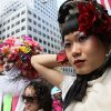 Shien Lee, of New York, right, poses for photographers as she and others take part in the Easter Parade along New York\'s Fifth Avenue Sunday April 24, 2011. (AP Photo/Tina Fineberg)