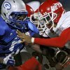 Western Heights\' Juan Woods runs into Guthrie\'s Richard Brothers during their high school football game in Guthrie on Friday, Oct. 28, 2011. Photo by John Clanton, The Oklahoman