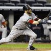 Boston Red Sox\'s Dustin Pedroia hits a first-inning, RBI double off New York Yankees starting pitcher David Phelps during their baseball game at Yankee Stadium in New York, Tuesday, Oct. 2, 2012. Jacoby Ellsbury scored on the play. (AP Photo/Kathy Willens)