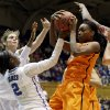 Duke\'s Alexis Jones (2), Allison Vernerey and Haley Peters, right, guard Oklahoma State\'s Toni Young during the first half of a second-round game in the women\'s NCAA college basketball tournament in Durham, N.C., Tuesday, March 26, 2013. (AP Photo/Gerry Broome) ORG XMIT: NCGB101