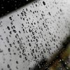 Rain beads on the rear window of a SUV parked in an Oklahoma City parking lot on Thursday, July 17, 2014. Photo by Jim Beckel, The Oklahoman