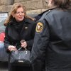 State Supreme Court Justice Joan Orie Melvin leaves the Allegheny County Courthouse Thursday, Feb. 21 2013 in Pittsburgh. Justice Joan Orie Melvin was convicted Thursday of corrupting the election process in her campaigns to win a seat on the bench, making her just the second known Supreme Court justice to be convicted in nearly three centuries and triggering renewed calls to change the system of electing state judges. (AP Photo/Tribune Review, Philip G. Pavely) PITTSBURGH OUT