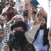 Supporters of Pakistani religious party Jamiat Ulema-e-Islam rally to condemn the killing of Osama bin Laden in Quetta, Pakistan, on Monday, May 2, 2011. al-Qaida chief Osama bin Laden was slain in his hideout in Pakistan early Monday in a firefight with U.S. forces, ending a manhunt that spanned a decade. (AP Photo/Arshad Butt) ORG XMIT: QUT106