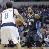 Photo - Orlando Magic point guard Jameer Nelson (14) looks to drive against Dallas Mavericks point guard Jose Calderon (8), of Spain, during the first half of an NBA basketball game, Monday, Jan. 13, 2014, in Dallas. (AP Photo/LM Otero)