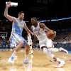 Oklahoma City\'s Kevin Durant (35) goes around Denver\'s Danilo Gallinari (8) during an NBA basketball game between the Oklahoma City Thunder and the Denver Nuggets at Chesapeake Energy Arena in Oklahoma City, Tuesday, March 19, 2013. Denver won 114-104. Photo by Bryan Terry, The Oklahoman