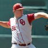 Photo - UNIVERSITY OF OKLAHOMA / OU / NCAA TOURNAMENT / NCAA BASEBALL TOURNAMENT: Oklahoma pitcher Jonathan Gray (22) throws a pitch during an NCAA college baseball regional game against Army in Charlottesville, Va., Sunday, June 3, 2012. (AP Photo/Andrew Shurtleff) ORG XMIT: VAAS101
