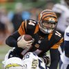 Photo - Cincinnati Bengals quarterback Andy Dalton (14) is tackled by San Diego Chargers linebacker Jarret Johnson in the second half of an NFL wild-card playoff football game on Sunday, Jan. 5, 2014, in Cincinnati. (AP Photo/Al Behrman)