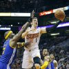 Phoenix Suns\' Goran Dragic (1), of Slovenia, drives past Golden State Warriors\' Jermaine O\'Neal (7) to score as Warriors\' Andre Iguodala, right, stands near during the second half of an NBA basketball game Saturday, Feb. 8, 2014, in Phoenix. The Suns won 122-109. (AP Photo/Ross D. Franklin)