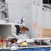 Miami-Dade Fire Rescue workers work the scene of a parking garage collapse at Miami-Dade College in Doral, Fla. on Wednesday, Oct. 10, 2012. A section of the under-construction parking garage collapsed, killing one worker and trapping two others in the rubble, officials said. At least 10 other workers were hurt. (AP Photo/The Miami Herald, Hector Gabino) MAGS OUT