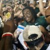 Baylor\'s Robert Griffin III (10) is surrounded by fans as he tries to leave the field after the college football game in which the University of Oklahoma Sooners (OU) were defeated 45-38 by the Baylor Bears (BU) at Floyd Casey Stadium on Sunday, Nov. 20, 2011, in Waco, Texas. Photo by Steve Sisney, The Oklahoman