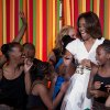 Photo - First lady Michelle Obama dances on stage with student performers as she and the President's Committee on the Arts and the Humanities (PCAH) host the White House Talent Show in the East Room of the White House, in Washington, Tuesday, May 20, 2014 in Washington. (AP Photo/Carolyn Kaster)