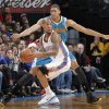 Photo - New Orleans Hornets' Anthony Davis (23) defends on Oklahoma City Thunder's Eric Maynor (6) during the NBA basketball game between the Oklahoma CIty Thunder and the New Orleans Hornets at the Chesapeake Energy Arena on Wednesday, Dec. 12, 2012, in Oklahoma City, Okla.   Photo by Chris Landsberger, The Oklahoman