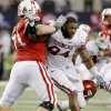 OU\'s Pryce Macon has his helmet knocked off by Nebraska\'s Jeremiah Sirles during the Big 12 football championship game between the University of Oklahoma Sooners (OU) and the University of Nebraska Cornhuskers (NU) at Cowboys Stadium on Saturday, Dec. 4, 2010, in Arlington, Texas. Photo by Bryan Terry, The Oklahoman