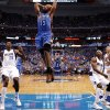Oklahoma City\'s James Harden (13) goes up for a dunk beside Dallas\' Ian Mahinmi (28) during Game 4 of the first round in the NBA playoffs between the Oklahoma City Thunder and the Dallas Mavericks at American Airlines Center in Dallas, Saturday, May 5, 2012. Oklahoma City won 103-97. Photo by Bryan Terry, The Oklahoman
