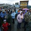 People gather Tuesday, March 25, 2014, at a candlelight vigil in Arlington, Wash., for the victims of a massive mudslide that struck the nearby community of Oso, Wash., on Saturday, killing at least 16 people and leaving dozens missing. (AP Photo/Ted S. Warren)
