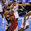Oklahoma City\'s Thabo Sefolosha (2) defends Miami\'s Dwyane Wade (3) during Game 1 of the NBA Finals between the Oklahoma City Thunder and the Miami Heat at Chesapeake Energy Arena in Oklahoma City, Tuesday, June 12, 2012. Photo by Sarah Phipps, The Oklahoman