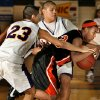 Douglass high school\'s Meatche Robinson (13) is fouled as he tries to dribble past Anadarko\'s Jordan Reed (23) and Cale Ware (44 in back) in Class 4A boys state tournament basketball at Moore High School on Thursday, March 6, 2008 in Moore, Oklahoma. BY STEVE SISNEY, THE OKLAHOMAN
