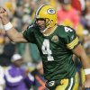 Photo - Green Bay Packers quarterback Brett Favre reacts after throwing a touchdown pass during the second half of an NFL football game against the Minnesota Vikings on Sunday, Nov. 11, 2007, in Green Bay, Wis. The Packers won 34-0. (AP Photo/Morry Gash)  ORG XMIT: WIMG111