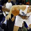 Charlotte Bobcats\' Byron Mullens, right, and Memphis Grizzlies\' Marreese Speights, left, chase the loose ball during the first half of an NBA basketball game, Saturday, Nov. 17, 2012, in Charlotte, N.C. (AP Photo/Chuck Burton)