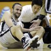 San Antonio Spurs\' Manu Ginobili (20), of Argentina, holds his knee after he was injured during the first quarter of an NBA basketball game against the Boston Celtics, Saturday, Dec. 15, 2012, in San Antonio. (AP Photo/Eric Gay) ORG XMIT: TXEG105