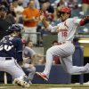 Photo - St. Louis Cardinals' Jon Jay scores past Milwaukee Brewers catcher Jonathan Lucroy during the first inning of a baseball game Thursday, Sept. 4, 2014, in Milwaukee. Jay scored from second on a hit by Yadier Molina. (AP Photo/Morry Gash)