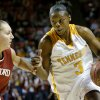 NORMAN, OK, TUESDAY, MARCH 30, 2004. STANFORD VS TENNESSEE WOMEN\'S COLLEGE BASKETBALL NCAA TOURNAMENT MIDWEST REGIONAL AT THE LLOYD NOBLE CENTER IN NORMAN, OK. Tennessee University\'s #3 Tasha Butts drives the ball past Stanfords #5 Kelley Suminski. Oklahoman staff photo by Ty Russell.