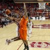 Oklahoma\'s Cameron Clark (21) goes to the basket beside Oklahoma State\'s Michael Cobbins (20) during the Bedlam men\'s college basketball game between the University of Oklahoma Sooners and the Oklahoma State Cowboys in Norman, Okla., Wednesday, Feb. 22, 2012. Oklahoma won 77-64. Photo by Bryan Terry, The Oklahoman