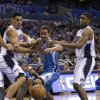 New Orleans Hornets\' Brian Roberts (22) goes after a loose ball between Orlando Magic\'s Gustavo Ayon, left, of Mexico, and E\'Twaun Moore, right, during the first half of an NBA basketball game on Wednesday, Dec. 26, 2012, in Orlando, Fla. (AP Photo/John Raoux)