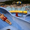 Brett Keel, 9, of Edmond, winds his way down a slide during the last day at Pelican Bay Aquatic Center in Edmond on Sept. 1, 2008. By John Clanton, The Oklahoman